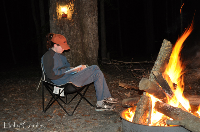 Reading by the campfire.