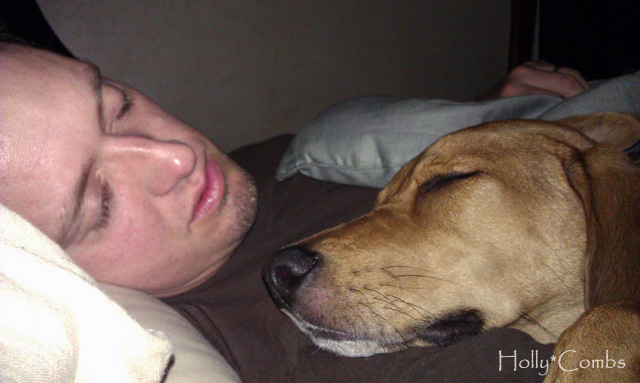 Husband and puppy sound asleep.