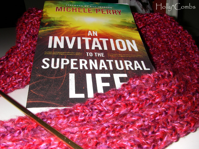 Knitting a scarf and reading An Invitation to the Supernatural Life.