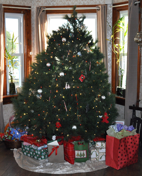 Our Christmas tree with gifts underneath.