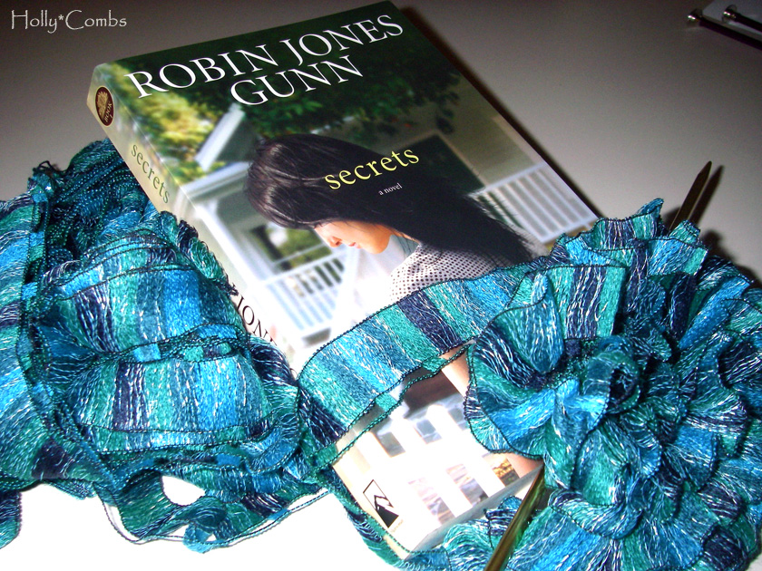 Yarn Along reading Secrets by Robin Jones Gunn.