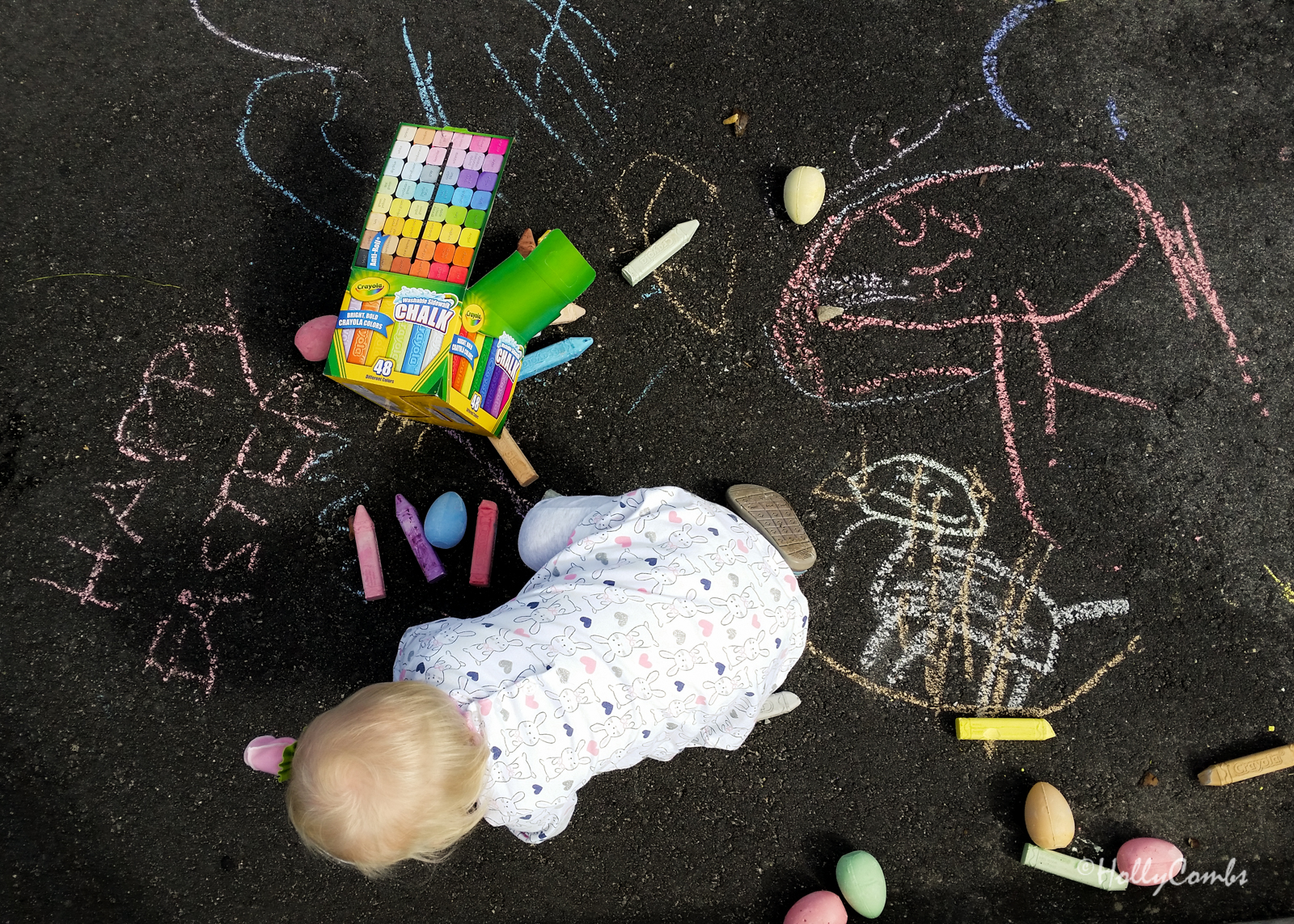 Fiona's first Easter egg hunt with sidewalk chalk.